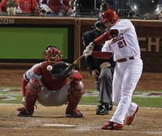 St. Louis Cardinals' Allen Craig hits a single during the ninth inning of Game 4 of baseball's World Series against the Boston Red Sox Sunday, Oct. 27, 2013, in St. Louis. (AP Photo/Charlie Riedel)