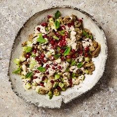 Yotam Ottolenghi's burnt aubergine with tahini, cucumber and pomegranate.