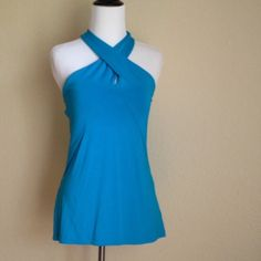 Ralph Lauren, SZ L & XL Gorgeous blue halter top, just in time for summer. This top is perfect for a casual day brunching with the girls or with your favorite skinny jeans on date night.  This really is a perfect piece and you know great quality when made by Ralph Lauren.  Please specify L or XL when you order.  I have two identical in those sizes only.  These tops are brand new, never worn, tickets still attached.  And of course 100% authentic. Ralph Lauren Tops