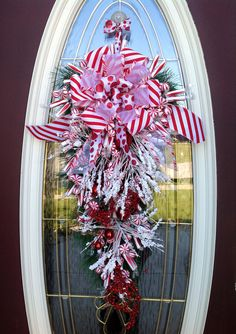"Christmas Wreath Winter Wreath Vertical Teardrop Door Swag Decor..""Peppermint Sensation"". $80.00, via Etsy."