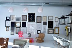 beautiful gallery wall...great mix of old & new!  buckingham-interiors-SHOWROOM-alt-4