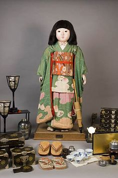Miss Fukushima : a Friendship Doll given from Japan to the US. 1927. She retains many of her original accessories, including her stand with label plate, her parasol, two pair of geta, numerous lacquered furnishings, a pair of lanterns, a tea ceremony set, and a metal work vase, among others.