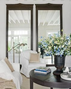 love these two mirrors that make the room seem larger and check out the reflection of that gorgeous ceiling in them
