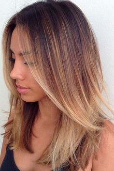 Medium length layered haircuts are not exactly the cuts that need no maintenance. On the other hand, there is so much ease and flexibility they offer! That is probably why so many women enjoy wearing them. What is more - such a haircut will flatter any complexion or shape.