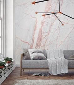 If you're after a show-stopping feature wall that's dripping in style. Look no further than this stunning marble effect wallpaper design. Veins of muted pink give this mural beautiful definition and natural pattern. Perfect for contemporary living room spaces.