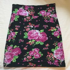 Bodycon Mini Skirt Black bodycon mini skirt with a pink and green floral print. Worn a few times but in great condition Forever 21 Skirts Mini