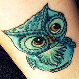 Feminine Owl Tattoos | Free Tattoo Designs Home Tattoo Advice 101 Tattoo Translations