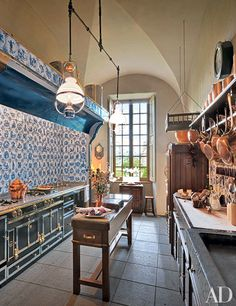 Copper cookware lines the shelves of a kitchen in Auvergne, France. For more shelf ideas and kitchen decoration tips, read on.