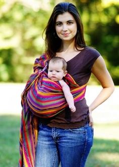 I like the hippie-chic of a ring sling...Maybe the extra fabric would annoy me--but it makes for a great nursing cover.