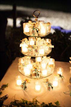 Sposarsi all'isola d'Elba - Getting married in Elba - Il tavolo della confettata e delle bomboniere allestite con un tocco di romanticismo. Il tema delle nozze il mare; il colore per eccellenza il tiffany. Sullo sfondo la spiaggia della Fenicia allestita con cuscini bianchi e blu e candele che illuminano la notte. www.weddinginelba.it #allestimento #matrimonio #spiaggia #mare #elba #tuscany Ph: Foto Morlotti STUDIO