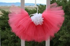 This fluffy coral tutu skirt offers yards of soft tulle with a satin polyester skirt lining under the tulle and a silky waistband made from the same fabric as the lining. A white peony flower accents the waist. This high quality skirt is fully sewn and the lining offers a comfortable fit. She will look stunning at any special occasion. Adorable hat shown in photo sold separately. Please allow 1~2 weeks for the making and shipment of this beautiful tutu. The final product may vary slightly…