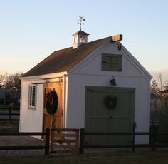 Sliding barn door on lane-side of shed.  Like cupola too without weathervane.