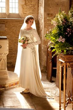 Edith's Wedding Dress was so pretty! The train and draping in the back especially!