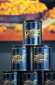 GARRETT POPCORN as a wedding favor. Buy 6.5g tin -104ppl approx/1.5-2 cups per bag ask rep for prices on stickers and bags individually to save money