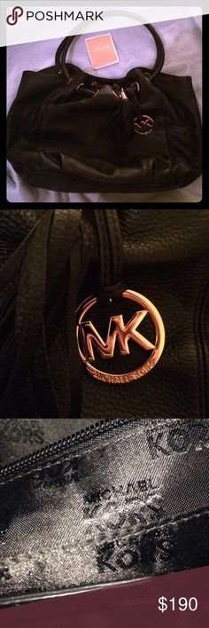 """BNWOT Michael Kors Medium Ring Tote EW Black Never used. No tags but will come with the original care card. Snap closure Made of leather. Approx. 14"""" x 9 3/4"""" x 5"""". Approx. 9"""" strap drop. Tab-snap closure. Interior zip, cell phone, and multifunction pockets. Fabric lining. Gold tone hardware. Michael Kors Bags Totes"""