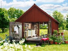 Summer kitchen in a red shed with barn doors at either end Outdoor Rooms, Outdoor Living, Ikea, Barn Kitchen, Potting Sheds, Summer Kitchen, Old Barns, Small Barns, Interior Exterior