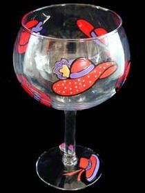 Red Hat Dazzle Design Hand Painted Grande Goblet by Bellissimo. $34.95. All Bellissimo! merchandise is exquisitely hand painted using an exclusively formulated non-toxic paint.. Every product is thoroughly inspected to meet our strict quality control criteria, and then fired twice to insure durability.. Highly collectible, each piece of Bellissimo! is individually signed by the artist.. For generations of pleasure and enjoyment, hand washing is recommended for all Bellissimo! me...