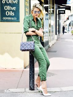 18401d87f6 An army green jumpsuit is worn with a chain shoulder bag