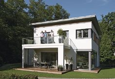City Life 700 Passivhaus - WeberHaus ➤ Fertighaus mit Flachdach ✔︎ Bilder ✔︎ Grundrisse ✔︎ Preise jetzt ansehen auf HausbauDirekt.de