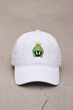 448c9aa25f7 A woven dad cap featuring an embroidered Marvin the Martian graphic and an  adjustable back strap