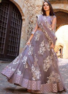 indian designer wear Dusty Purple and Silver Embroidered Lehenga features a dhupioni silk blouse with net sleeves, net lehenga with santoon inner and net dupatta. Embroidery work o Indian Lehenga, Silk Lehenga, Indian Gowns, Indian Attire, Bridal Lehenga, Pakistani Dresses, Anarkali, Indian Wear, Pakistani Clothing