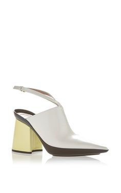 This **Marni** slingback is rendered in leather and features a pointed toe and unique color blocking.