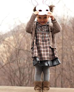 """""""In this image: Cardigan (1658C608P); Dress (4BVX5V3R0); Tights (6AO3B2067); Shoes (8H8YC063B). Winter 2012 United Colors of Benetton Toddler collection."""""""