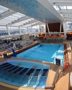 Glass-canopied retreat. The Solarium onboard Quantum of the Seas is an indoor pool with a retractable roof that closes automatically and silently for cooler or inclement weather days.