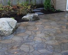Flagstone patio crazy-paving with boulder accents
