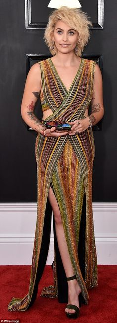 Flashing the flesh: Paris Jackson, 18, glittered in a colorful gown with cut-outs and rain...