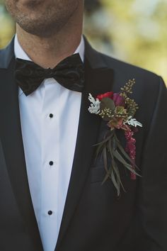 boutonniere + black patterned bow tie
