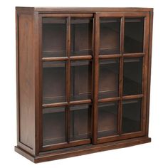 "HOME DECOR – FURNITURE – BOOKCASE – Pine wood bookcase in walnut with paned glass doors.  Product: BookcaseConstruction Material: Pine wood and glassColor: WalnutFeatures: Spacious shelves provide ample storageDimensions: 40.2"" H x 37.8"" W x 11.4"" D"