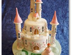 Our Fairy Princess Castle Cake. This two tiered cake is 100% edible. Towers were filled with surprise treats for the birthday girl. For Heav...
