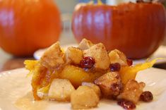 apples and cranberries baked in a pumpkin! creative & delicious :)