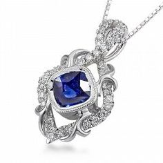 Riddle's Jewelry Ladies Parade™ White Gold Sapphire and Diamond Pendant (05835047)