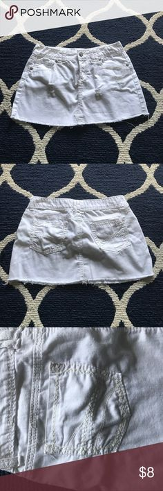 """White denim skirt Reign white denim skirt. Size 9. Factory distressing. Rhinestone detail on grommets and front button. Measures approx. 11 1/2"""" length in front and 12 1/2"""" length in back. Worn once. Reign Skirts"""