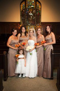 Love this color bridesmaids dress with the orange, red, yellow flowers