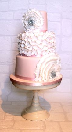 Warm pink wedding cake.  Ruffle flowers and bling centers.  Gorgeous!