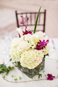 orchids, purple & white floral centerpiece /  Elaine Palladino Photography