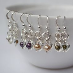 Linkouture sells sterling silver and freshwater pearls earrings in a variety of colors