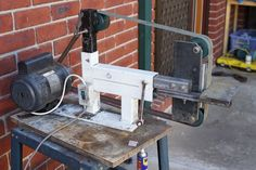 Belt Grinder by mrlocchoc -- Homemade belt grinder fabricated from tubing, flat bar, MDF, longboard wheels, and hardware. Powered by a surplus 3 HP water pump motor. http://www.homemadetools.net/homemade-belt-grinder-57