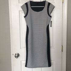 NWT Material girl dress Black and white striped bodycon dress. Fits mid calf, scoop neck, 95% polyester, 5% spandex. Material Girl Dresses Midi
