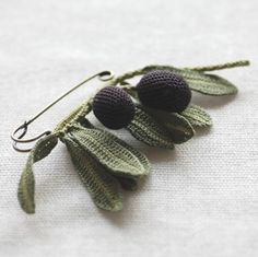 great olive pin but would also make adorable mistletoe with white berries.  no pattern just a photo.