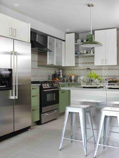 retro contemporaryl kitchen.  vintage green pendants, aluminum stools, green lowers, and multicolored brick backsplash   sarah richardson