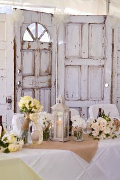 rustic doors as a backdrop to the sweetheart table or dessert table.