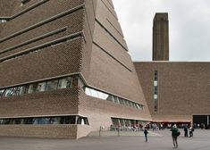 "Brick exterior of Tate Modern museum's ""Switch House"" extension by Herzog & de Meuron - photo by Jim Stephenson, via dezeen; in London, England (2016)"