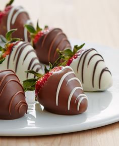 Swizzled strawberries dipped  in milk, white and dark confection. | @sharisberries