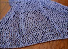 """Take a look at this gorgeous #FreeKnittingPattern for an eyelet shawl donated for the Purple Stitch Project! Click the image to learn more and get your free instant download of the pattern, and click """"Repin"""" to spread the word about the Purple Stitch Project and help kids with seizure disorders! #knitting #pattern #PurpleStitchProject"""