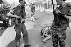 (3 of 3) South Vietnamese forces escort suspected Viet Cong officer Nguyen Van Lem (also known as Bay Lop) on a Saigon street Feb. 1, 1968, early in the Tet Offensive.