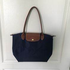 Navy blue Longchamp AMAZING condition has hardly been used, long champ le pliage small tote Longchamp Bags Totes
